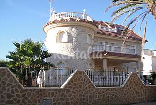 Luxury villa with lateral sea views, seven bedrooms and 50 meters from La Zenia beach. Alicante