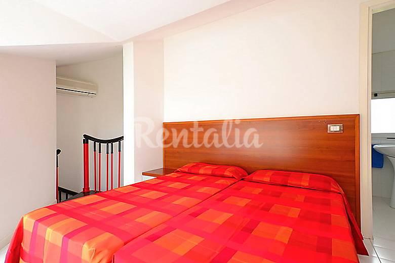 Dormitorio Udine ~ Apartamento para 4 personas con piscina Lignano Sabbiadoro (Udine) Alpes italianos