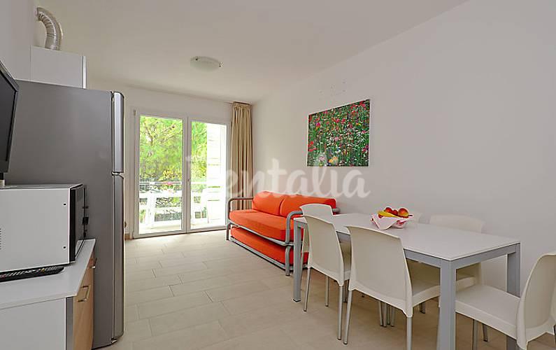 Dormitorio Udine ~ Apartamento para 7 personas con piscina Pineda, Lignano Sabbiadoro (Udine) Alpes italianos