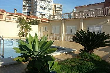 Villa para 8 personas en 1a l nea de playa el perellonet for Piscinas publicas valencia