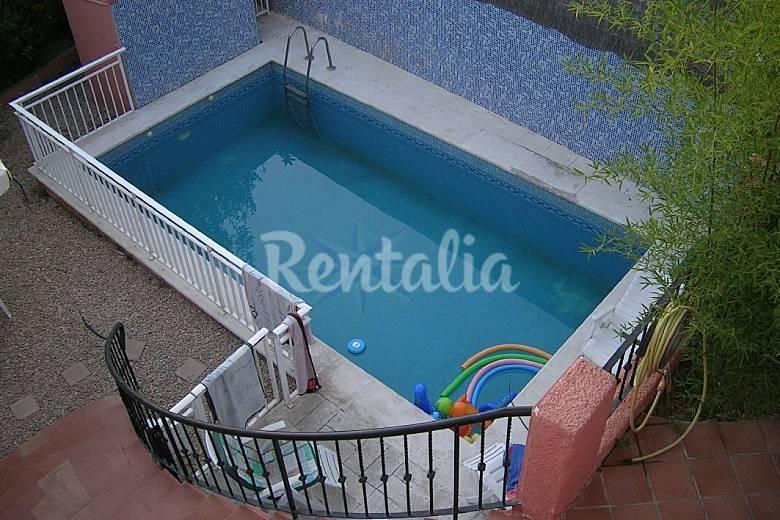 Casa grande para 14 personas con piscina monte vedat for Piscina jardin valencia