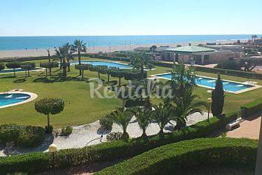 Primera linea de playa bajo con jard n vera playa vera for Jardin 88 doris vera hermoza