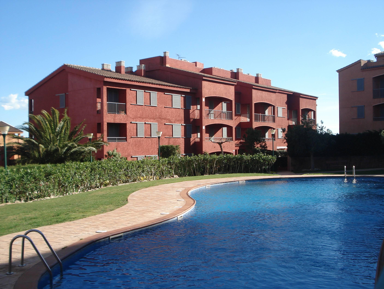 Planta baja con jardin y piscina l 39 ametlla de mar for Piscina y jardin 2002 s l