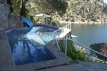 Casa noray en 1 linea del pantano del san juan costa for Piscina climatizada san martin de valdeiglesias