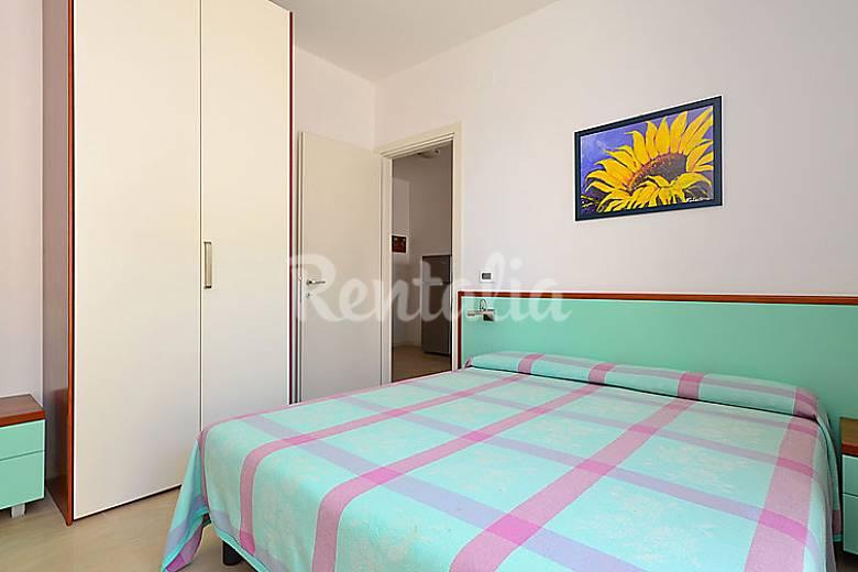 Dormitorio Udine ~ Apartamento en alquiler en Udine Pineda (Lignano Sabbiadoro Udine) Alpes italianos