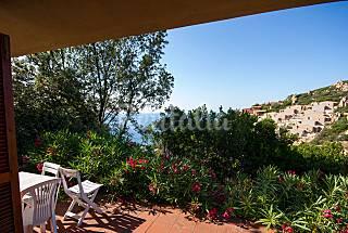 Villa con una gran terraza con vistas al mar y bar Olbia-Tempio