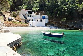 Isolated beach house with motorboat Split-Dalmatia